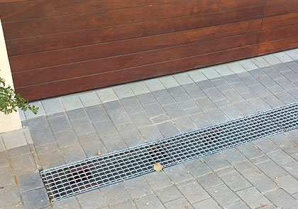 Drain prevents rain from entering garage