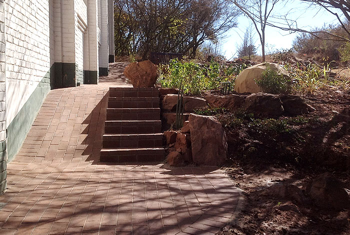 Steps and wheel chair ramp.